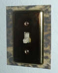 Once the screws are tightened, the switchplate securely holds the frame to the wall.