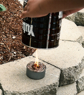 6. When you're ready to cook, light the wick and set the coffee can over the wax-filled tuna can.