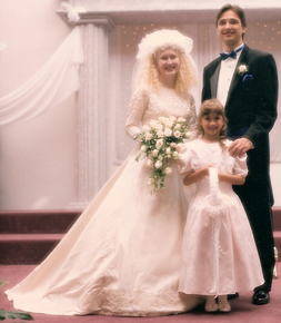 In her beautiful thrift-store wedding gown, Aimee stands proudly next to the groom and flower girl. Watch for future posts about other amazing cost-cutters at Aimee's elegant yet Fiercely Frugal wedding.