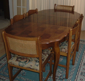 Although the chairs are quite dissimilar at first glance, they blend together as a set at the dining-room table.