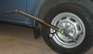 Slipping the vacuum handle over the lug wrench provides enough leverage to turn the lug nuts on my 1983 Dodge Colt.