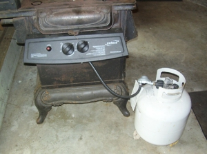 : The barbecue's controls are mounted on the side of the stove. Eventually, Carmen will hook it up to a regular propane line instead of the portable tank.