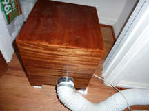 Exhaust hose enters wooden box