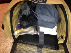 This carrier, with Joyce's purse, jacket, liquids bag, and laptop, goes in the overhead bin.