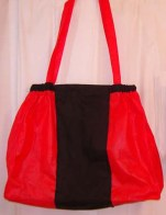 The vertical stripe of black cotton fabric hides the bag's logo.