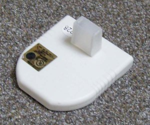 A slip-on plastic cover that came with another electrical device protects the nightlight's prongs from damage.